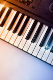 Synthesizer keyboard with shine and blue red gradient top view Royalty Free Stock Image