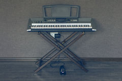 Synthesizer Keyboard. On stand with pedal Royalty Free Stock Photo