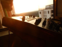 Synthesizer outdoor with sunset in background Royalty Free Stock Images