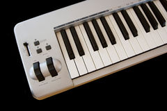 Synthesizer piano keys. Synthesizer piano keyboard on black background Stock Photography