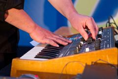 Synthesizer with sound effects. Playing the synthesizer with some sound effects in a rock band Stock Image