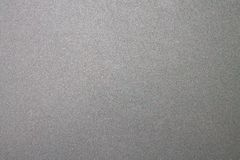 Synthetic cardboard texture, dark gray tone. Gray tone, sheet of paper background royalty free stock image