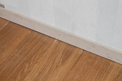 Synthetic cement wood plank border. On concrete wall stock photography