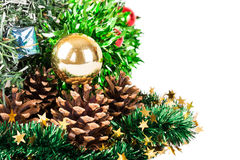 Synthetic Christmas tree with colored balls on branches and fir. Christmas tree with decorations  on white background and fir cones Stock Photos