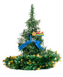 Synthetic Christmas tree with colored ribbon and bow on branches. Christmas tree with decorations isolated on white background, green and bright Royalty Free Stock Photo