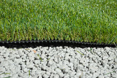 Synthetic grass. Applied on cemented gravel Royalty Free Stock Photography