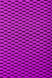 Synthetic magenta cloth. grid closeup. macro Stock Photo