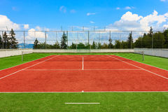 Synthetic outdoor tennis court Stock Photos