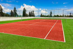 Synthetic outdoor tennis court. In red and green Royalty Free Stock Images