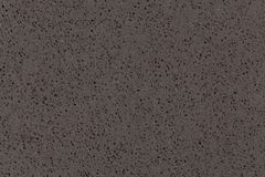Synthetic quartz stone texture, dark grey tone. royalty free stock photo
