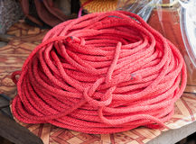 Synthetic red rope Stock Images