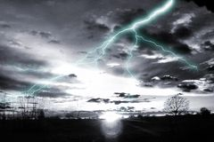 Synthetic storm. Odd scene of lightening and sunset in greyscale Stock Images