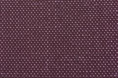 Synthetics fabric texture. Mauve background royalty free stock images