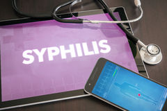 Syphilis (infectious disease) diagnosis medical concept. On tablet screen with stethoscope Stock Images