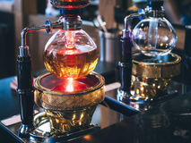 Syphon Coffee Maker display in Cafe Restaurant. Syphon Coffee Maker boiling water display in Cafe Restaurant Stock Images