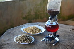 Syphon Coffee Maker. On wooden table Stock Photography