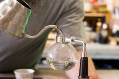 Syphon coffee in the making. In natural light Royalty Free Stock Photos