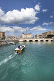Syracuse, Italy. A boat crosses the canal in the city. Royalty Free Stock Image