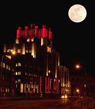 Syracuse, new york at night. Building lit up for the holiday season in syracuse,ny at night with full moon stock photography