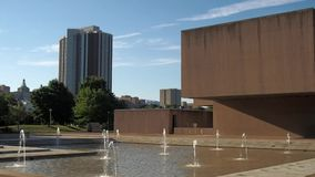 The Everson and Presidential Plaza. Syracuse, New York, USA. July 4, 2018. View of downtown Syracuse with The Presidential Plaza and Everson Museum of Art stock footage