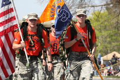 Syracuse ROTC marching the boston marathon. BOSTON - APRIL 16 : Fans cheer on Syracuse ROTC marching the boston marathon in full 40 lb ruck-sacks during the Royalty Free Stock Photography