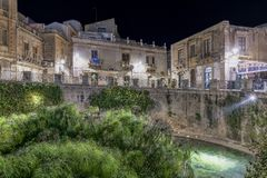 Syracuse Sicily. Source Aretusa in the night stock photography