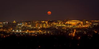 Syracuse University Syracuse New York. Supermoon over Syracuse University in Syracuse New York. The Carrier Dome as well as the rest of the university hill is Royalty Free Stock Image