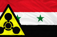 Syria crisis. Flag of Syria with the chemical weapons sign  waving with highly detailed textile texture pattern representing the chemical attack Inside the Royalty Free Stock Photo