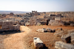Syria - The Dead Cities. Serjilla is one of the Dead Cities in Syria. Unique among Roman / Byzantine ruins and suddenly abandoned in the past. Tilt-shift shot stock image