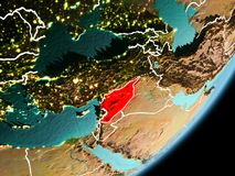 Orbit view of Syria. Syria in early morning light highlighted in red on planet Earth with visible border lines and city lights. 3D illustration. Elements of this Royalty Free Stock Photos