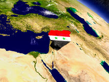 Syria with embedded flag on Earth Stock Photo