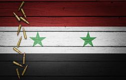 Syria flag with bullets on wooden background Royalty Free Stock Photo