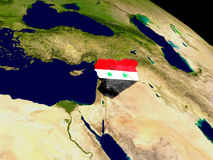 Syria with flag on Earth Stock Image