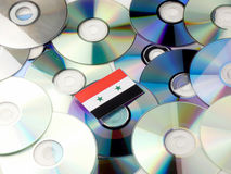 Syria flag on top of CD and DVD pile isolated on white Royalty Free Stock Photo