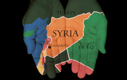 Syria In The Hands Of The People. Map Painted On Hands Showing The Concept Of Syria In The Hands Of The People Stock Image