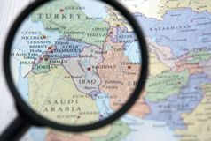 Syria and the Middle East on a map. Seen through a magnifying glass Stock Images