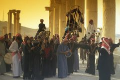 SYRIA PALMYRA ROMAN RUINS. People in the desert at the Roman Ruins of Palmyra in Palmyra in the east of Syria stock photography
