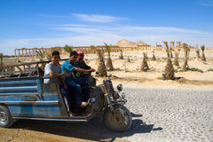 Syria , Palmyra. Syrian men riding on a motorbike in the desert Royalty Free Stock Photography