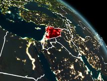 Syria in red at night. Syria from orbit of planet Earth at night with visible borderlines and city lights. 3D illustration. Elements of this image furnished by Stock Photography