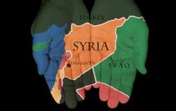 Syria W rękach ludzie obraz stock