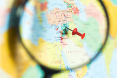 Syria on the world map with a magnifying glass royalty free stock photography
