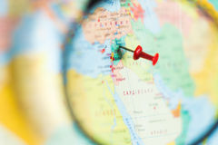 Syria on the world map with a magnifying glass Stock Photography