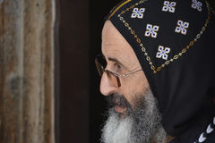 Syriac Orthodox Monk in Traditional Head Covering. Portrait of a Syriac Orthodox monk wearing the embroidered cap of his order Stock Photos