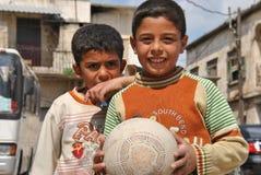 Syrian Boys. Boys posing at Apamea after playing football Stock Photo