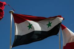Syrian flag. Flying in Barcelona Stock Photo