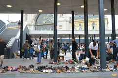 Syrian migrants choose shoes donated by the people of Budapest, near the international railway station Royalty Free Stock Photography