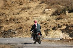 Syrian Refugee on Motorcycle Stock Images