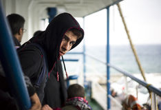 Syrian Refugee. 21/10/2015. Samos, Greece. A young, male, Syrian, refugee, travels on-board a ferry to Lesbos royalty free stock image