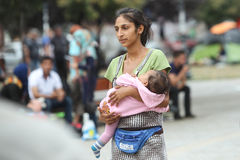 Syrian refugee woman with child in Belgrade Royalty Free Stock Images