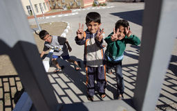 Syrian refugees Bulgaria. Unidentified syrian refugees boys shows peace sign in detention center in the town of Pastrogor on September 25, 2013 in Pastrogor Royalty Free Stock Images